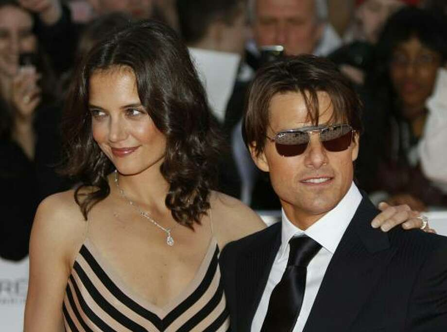 Katie Holmes became a stepmom at age 27 when she married Tom Cruise. Cruise has two children with ex-wife Nicole Kidman. Photo: STRINGER, AFP/Getty Images