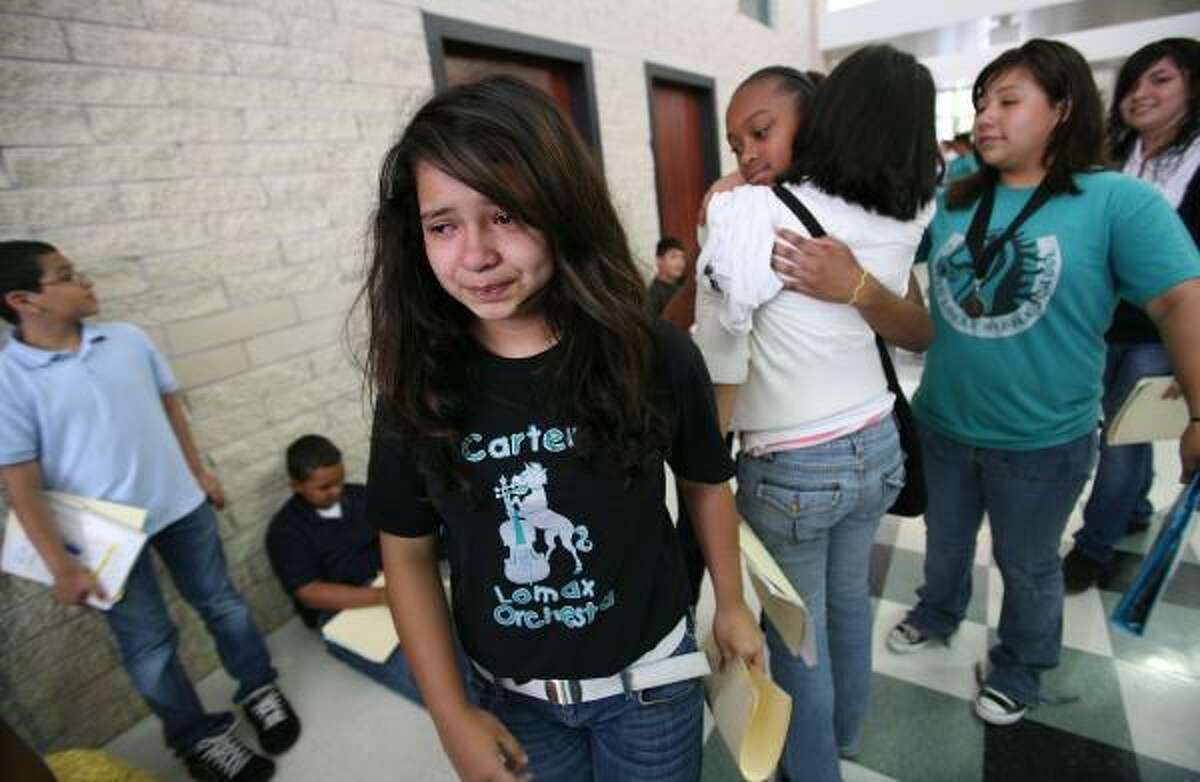 Ariana Villanueva, 12, cries as she walks out of the building for the last time as 6th graders say good-bye to each other on the last day of school at Carter Lomax Middle School in Pasadena.