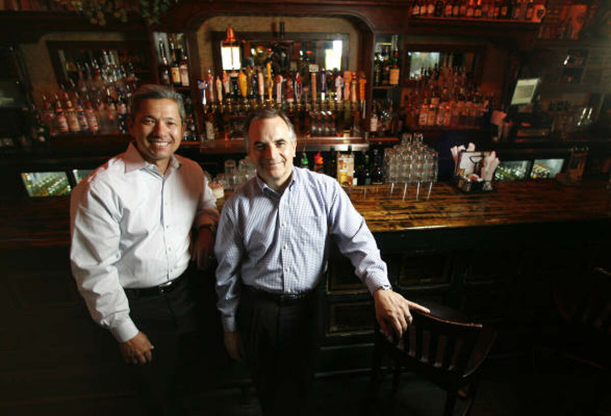 Edgar Carlson, left, and Larry Martin, co-owners of Hospitality USA, have pubs in Texas, Colorado and Oklahoma, and soon one in Florida.