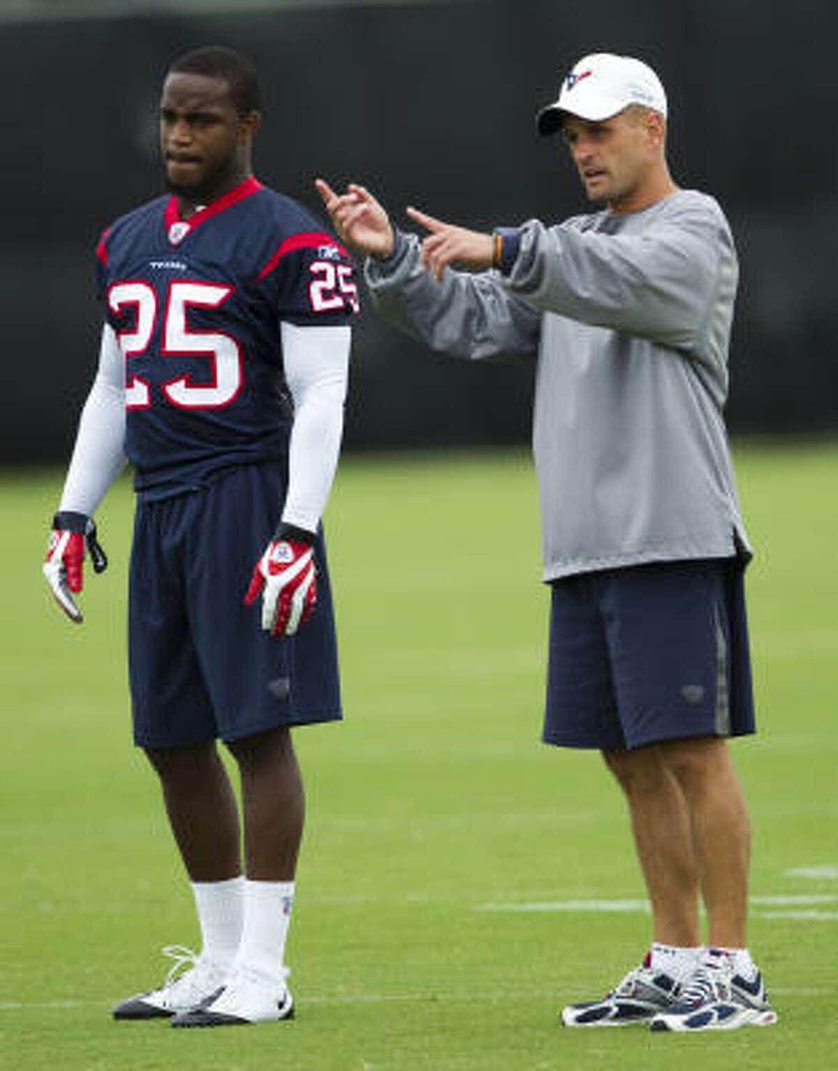 Texans defensive backs coach David Gibbs, right, works with rookie cornerback Kareem Jackson.