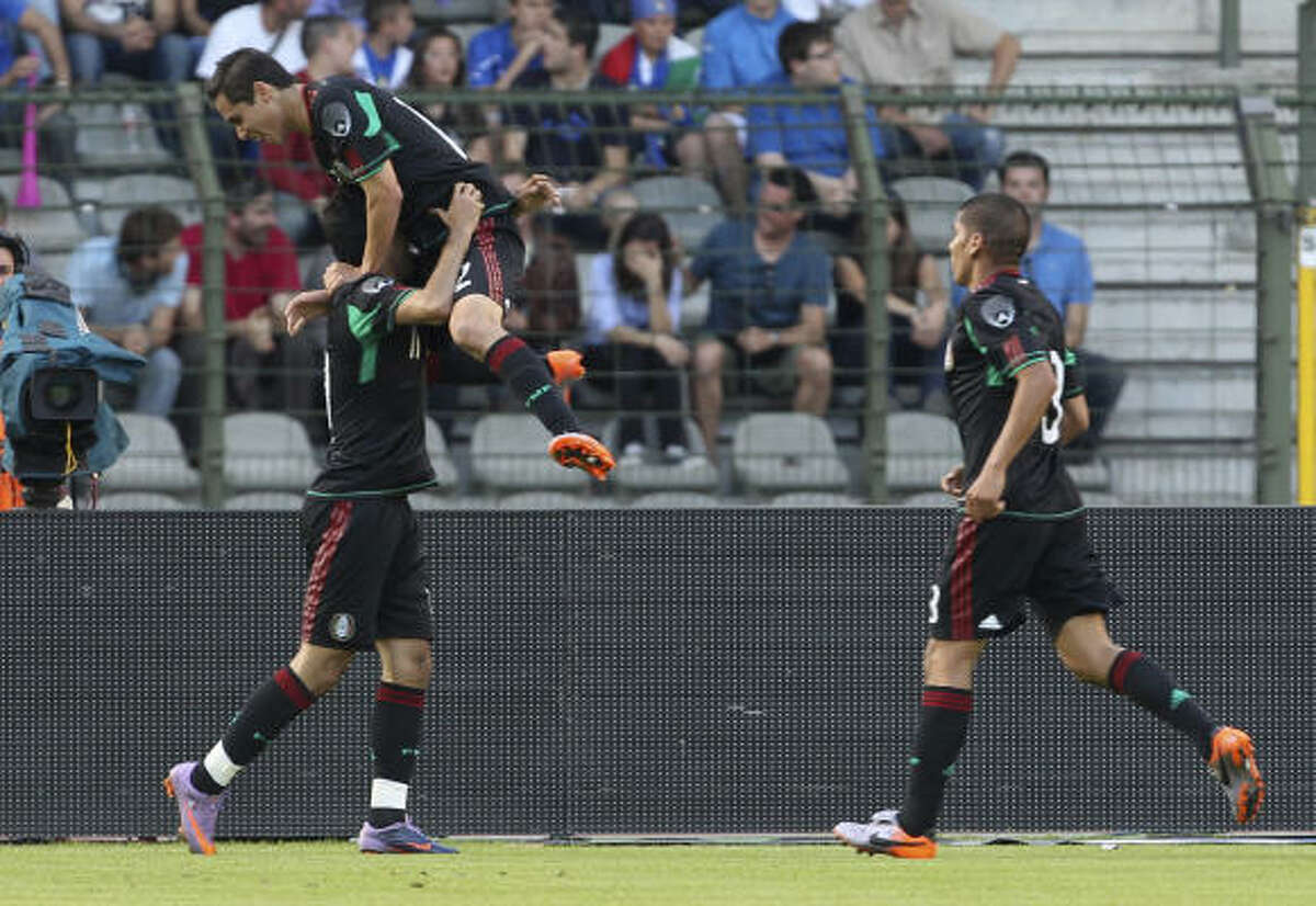 Mexico players celebrate after Carlos Vela, bottom left, scored against Italy at the King Baudouin stadium in Brussels.