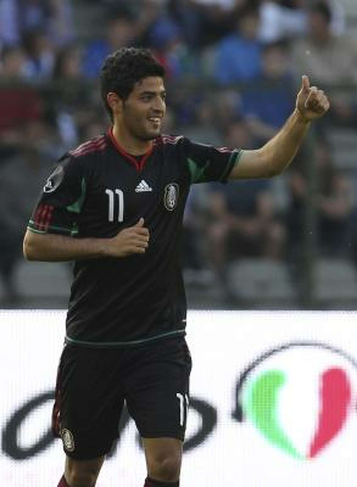 Mexico's Carlos Vela shows thumbs up after scoring the game's first goal in the 17th minute.