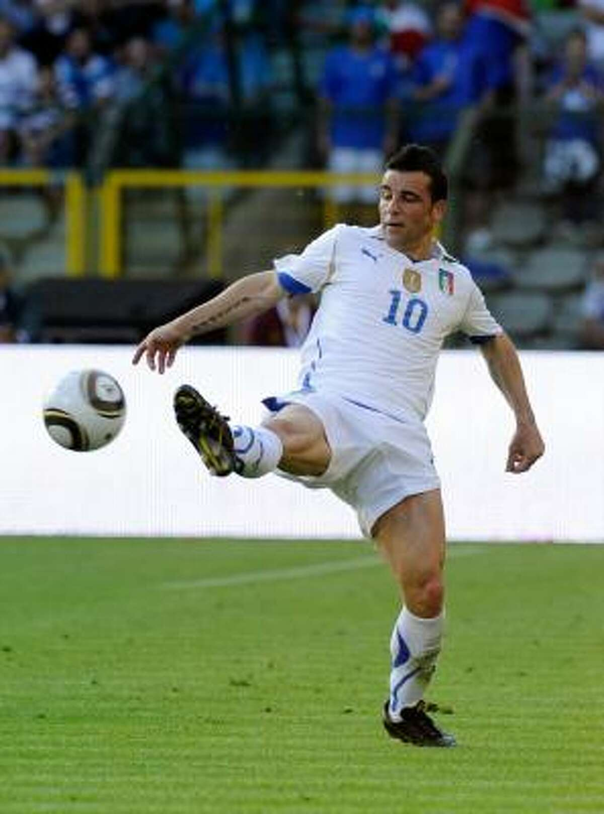 Antonio Di Natale of Italy controls the ball. The match was played at the Heysel stadium in Brussels. Before the match, players paid tribute to the 39 people, mostly Juventus fans, who died 25 years ago when a wall collapsed as they waited to watch their team play Liverpool in the European Cup final in this stadium. Another 600 fans were injured.
