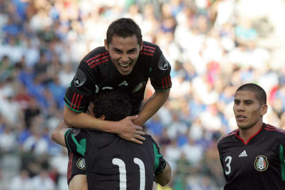 Mexico's Paul Aguilar celebrates with teammates. Photo: Francois Walschaerts, AP