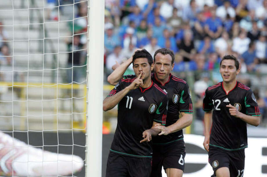 Mexico's Carlos Vela and Gerardo Torrado celebrate a goal against the world champs. Photo: Francois Walschaerts, AP