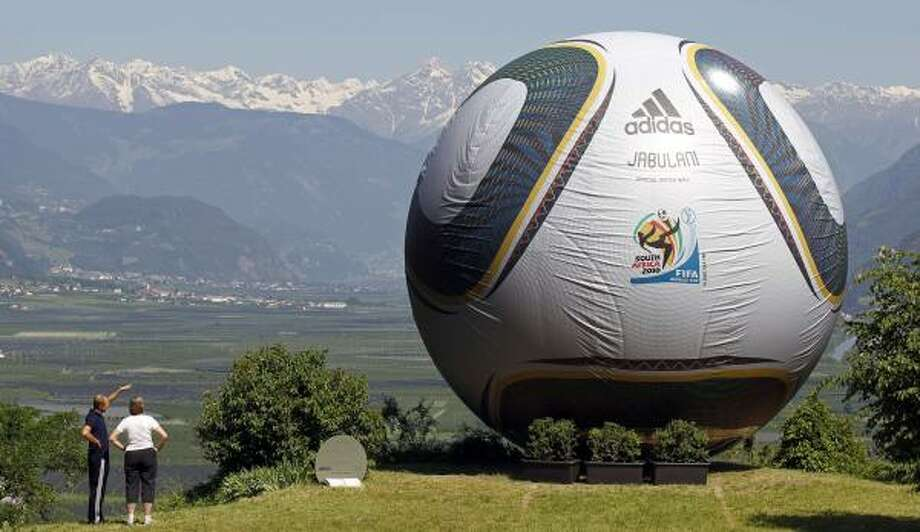 "The world's biggest Jabulani, is seen in Eppan, Italy. The newest Adidas ball is the official one for the 2010 World Cup but has also caused a giant controversy among some players, who have labeled the ball ""strange"" and ""weird"" for its dimples and ridges that affect its flight path. One goalkeeper compared it with ""cheap ones bought in a supermarket."" Photo: Matthias Schrader, AP"