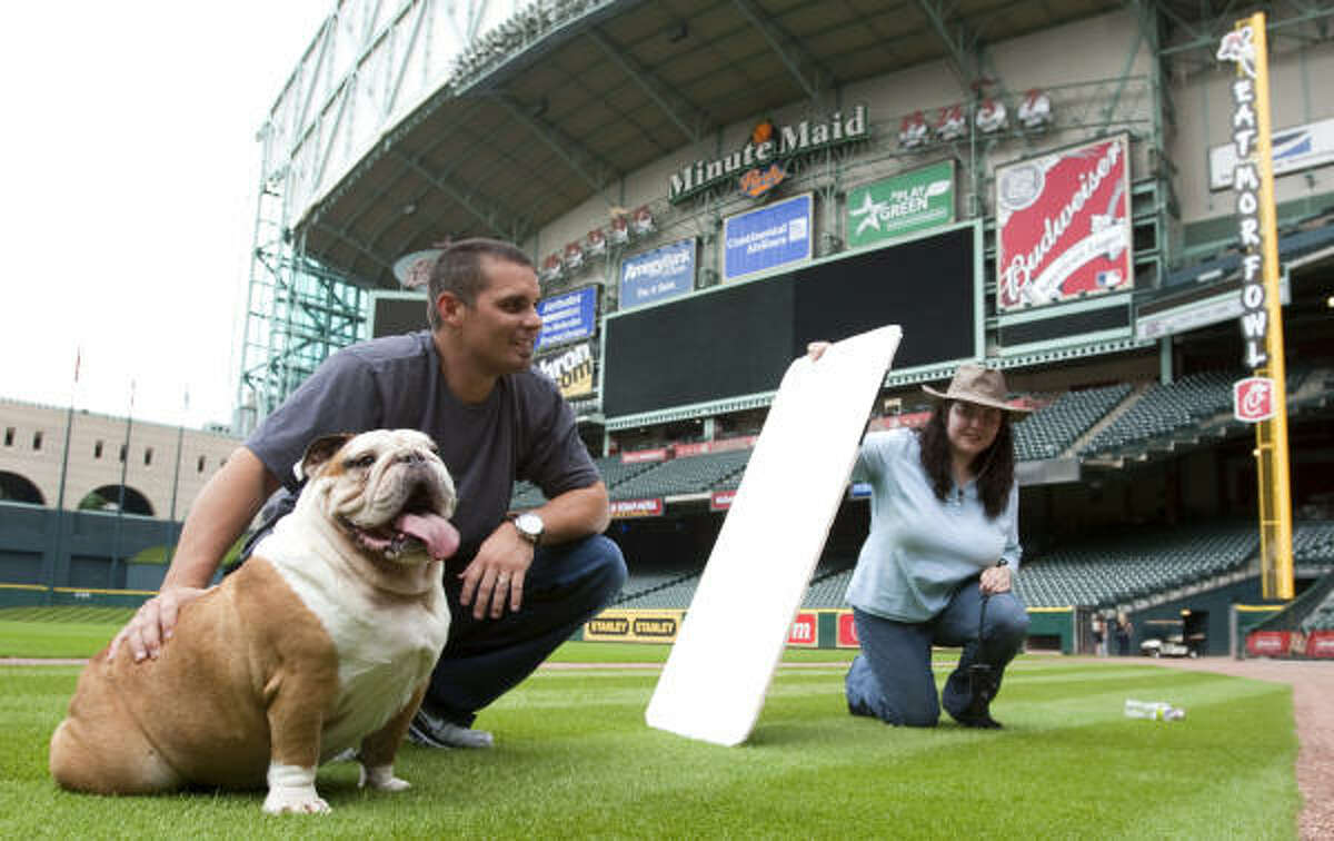 Houston Astros catcher Kevin Cash poses for a photo with his bulldog Kacey.