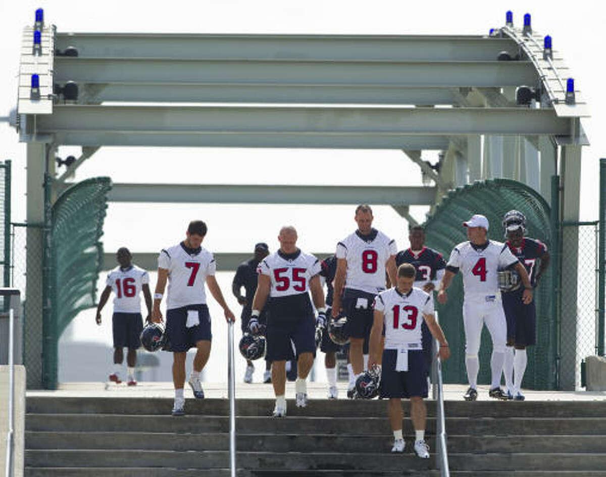 Texans players walk across the Kirby street bridge to their practice facility before OTAs.