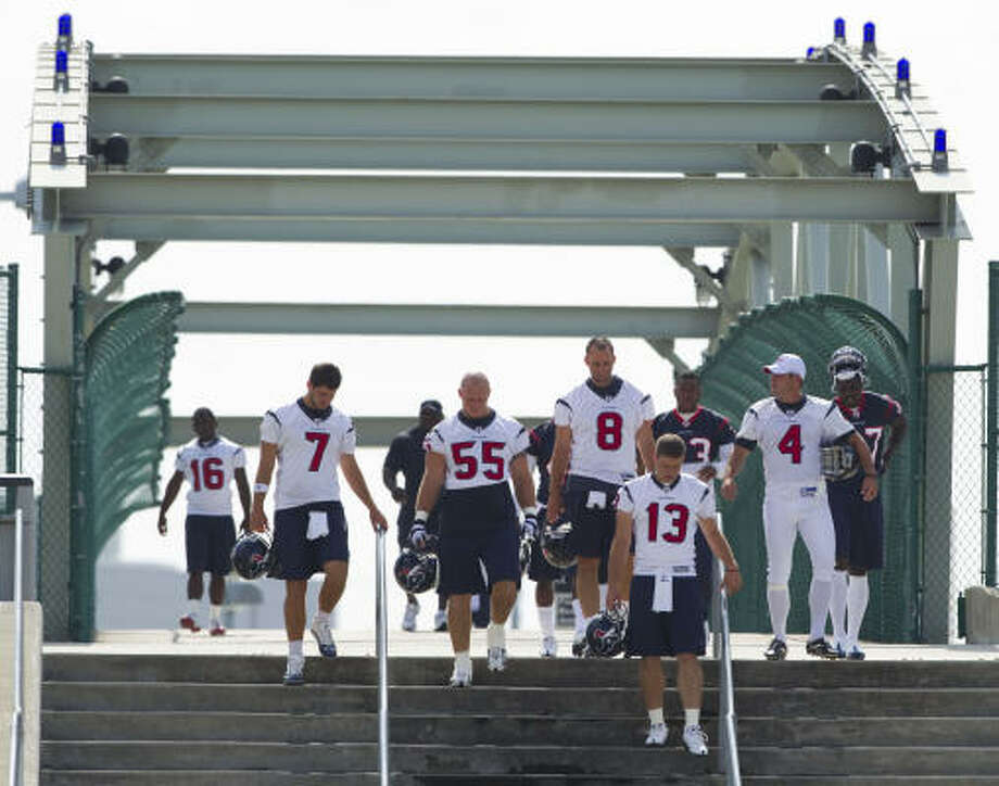 Texans players walk across the Kirby street bridge to their practice facility before OTAs. Photo: Brett Coomer, Chronicle