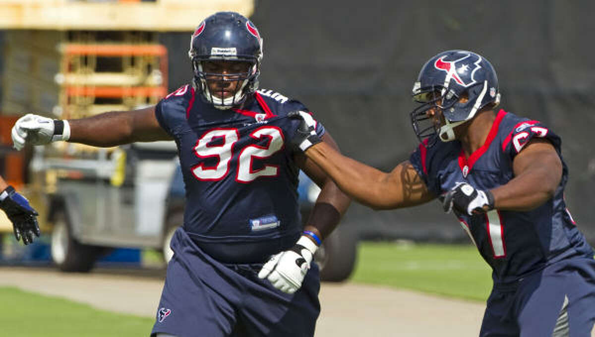 Texans defensive linemen Earl Mitchell, left, and Malcolm Sheppard run drills.