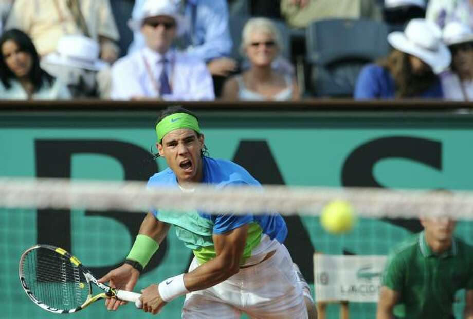 June 2: Quarterfinals  Four-time champion Rafael Nadal beat No. 19 Nicolas Almagro 7-6 (2), 7-6 (3), 6-4 in an all-Spanish quarterfinal. Photo: BORIS HORVAT, AFP/Getty Images