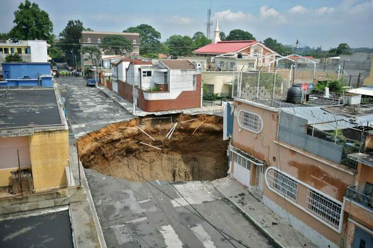 View of a huge crater caused by a landslide from rains of tropical storm Agatha, in Guatemala City, on May 31, 2010. Agatha, the first in a season of tempests that annually strikes the region, was especially brutal in Guatemala, where mudslides proved deadly.