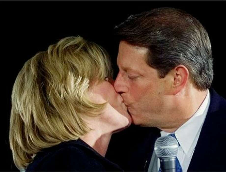 Then-Vice President Al Gore kisses his wife, Tipper, as he steps onto the stage at the Democratic National Convention on Aug. 17, 2000, in Los Angeles. Photo: Stephen Savoia, AP