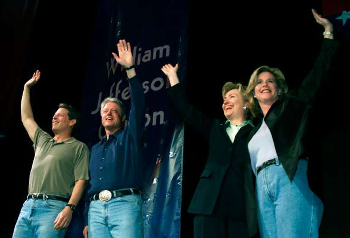 Vice President Al Gore, President Bill Clinton, first lady Hillary Rodham Clinton and Tipper Gore wave to the crowd during a Democratic National Committee fundraiser May 24, 2000, at the MCI Center in Washington, D.C.