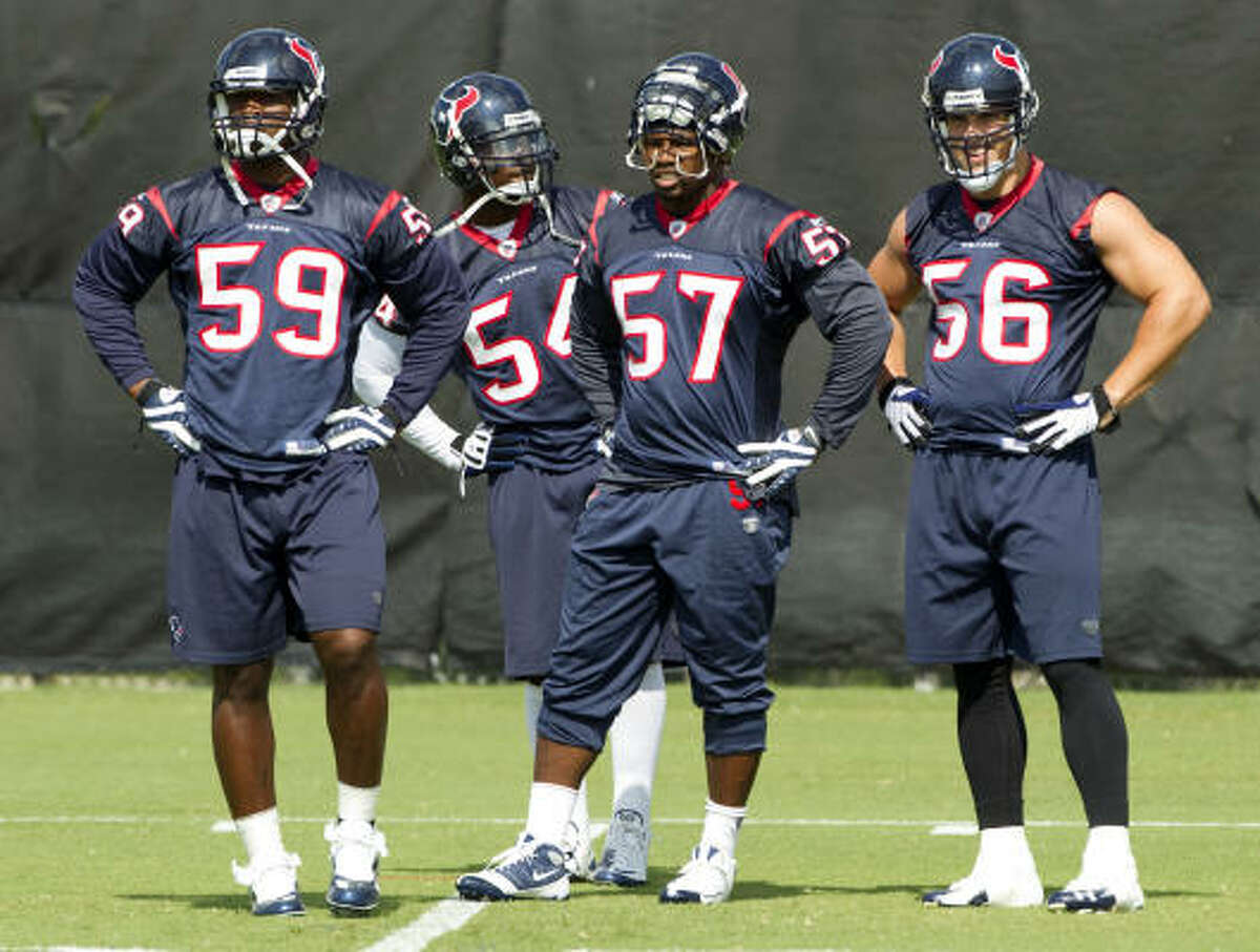 Texans linebacker DeMeco Ryans (59), Zac Diles (54), Kevin Bentley (57) and Brian Cushing (56) stand together between drills.