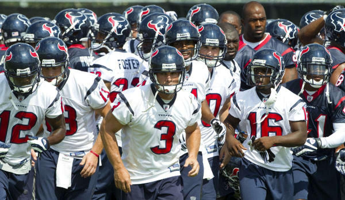 Kicker Kris Brown (3) leads the way as the Texans break their team huddle during OTAs.