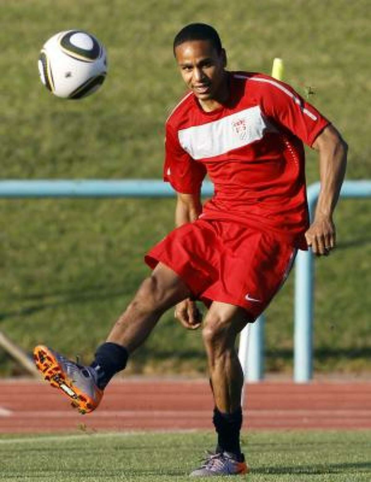 U.S. midfielder Ricardo Clark controls a ball during training.