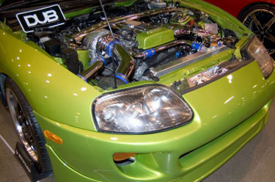 The DUB Show Tour featured hundreds custom cars, large wheels, beautiful models and rappers such as Yo Gotti, Trae and Swag. Check out these quick pics from Houston Rides blogger Mike Hinojosa for a snapshot of what went down. Photo: Mike Hinojosa