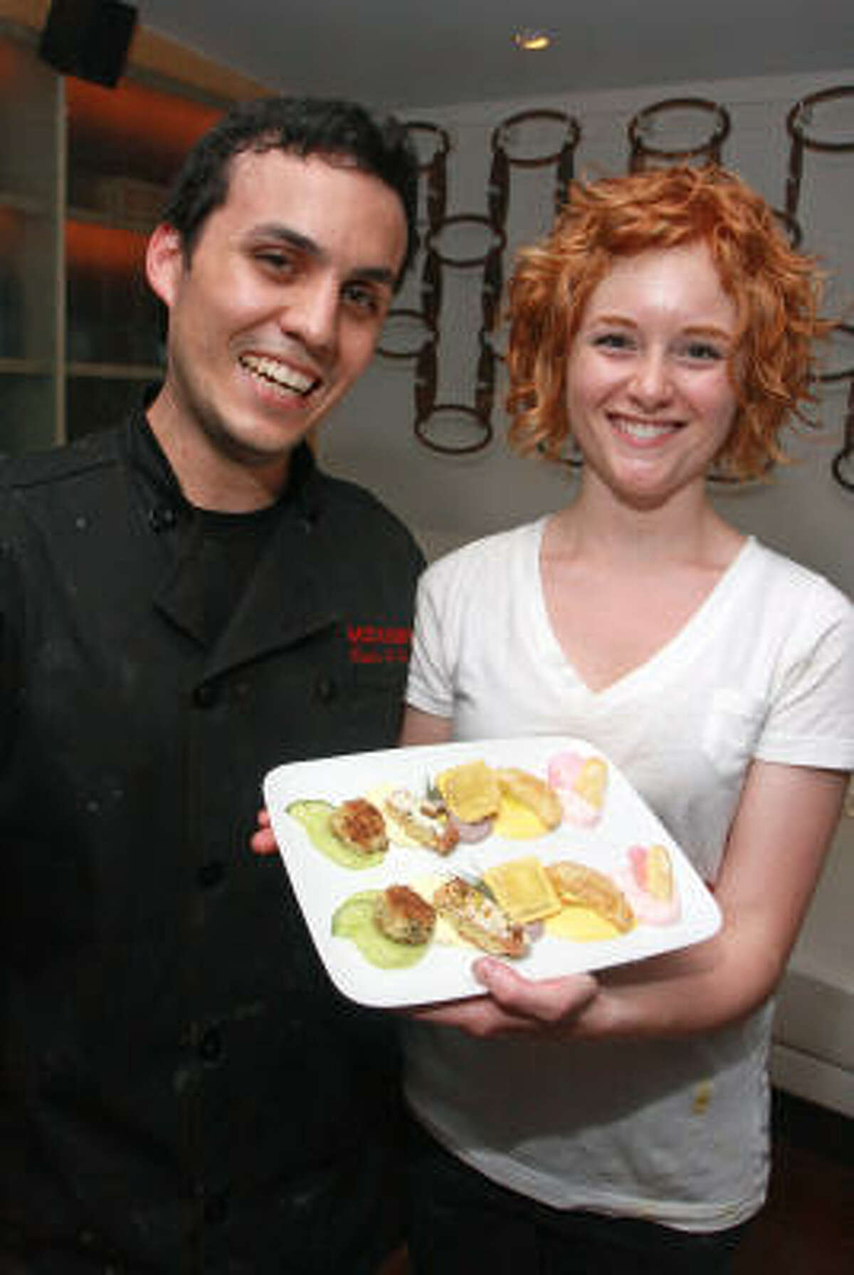 Carlos Ballon and Brittany Pool with a tray of hors d'oeuvres that Brittany designed and calls