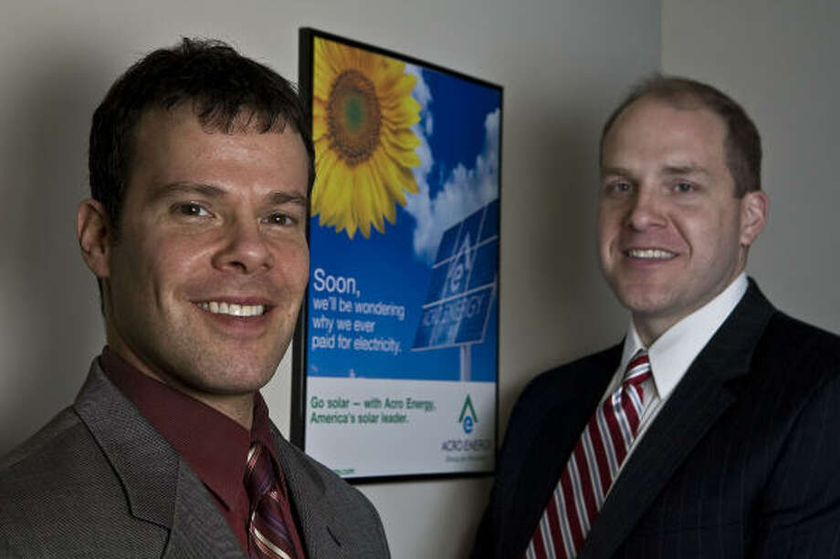 Two of Acro Energy's leaders are Brad Kovnat, left, business operations director, and Marty Spake, the chief financial officer. Spake said Acro wants to expand its solar panel program. Photo: James Nielsen, Chronicle