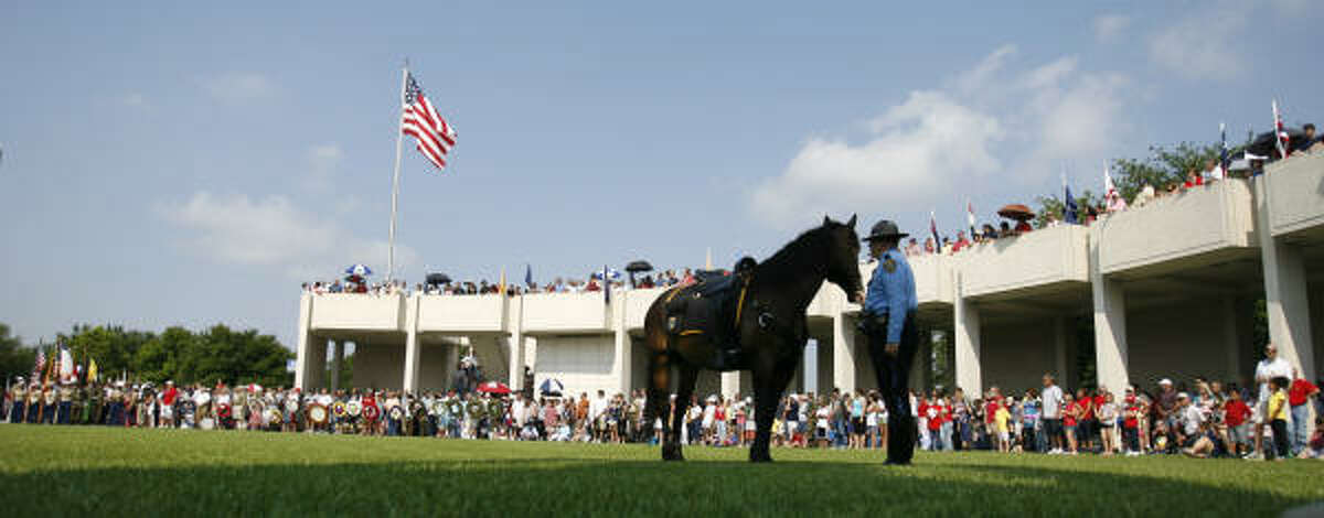A member of the Houston Police Mounted Patrol holds the