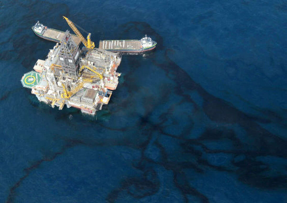 Oil is seen around a rig at the site of the Deepwater Horizon spill Monday in the Gulf of Mexico near the coast of Louisiana.