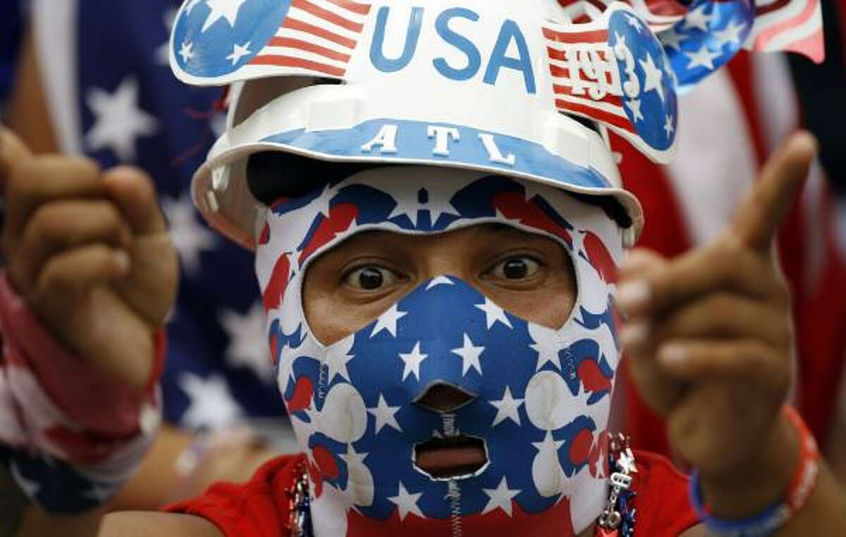 A United States fan cheers before a World Cup warmup soccer match against Turkey.