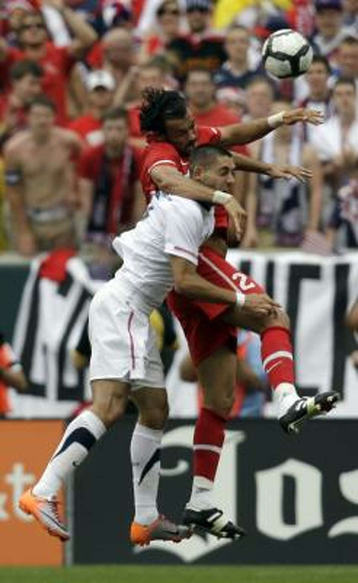 United States' Clint Dempsey, bottom, battles with Turkey's Servet Cetin for possession of the ball.