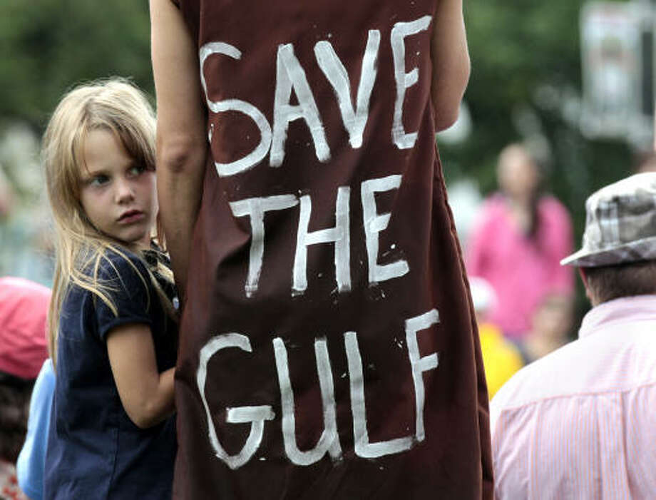 Jolie Van Gilder holds her mother's hand during a rally against BP and the Gulf oil spill Sunday in New Orleans. Photo: Jae C. Hong, Associated Press