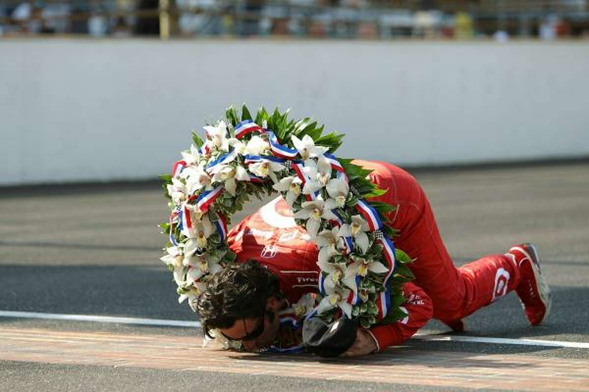 Dario Franchitti kisses the yard of bricks on the front stretch after winning the Indy 500.
