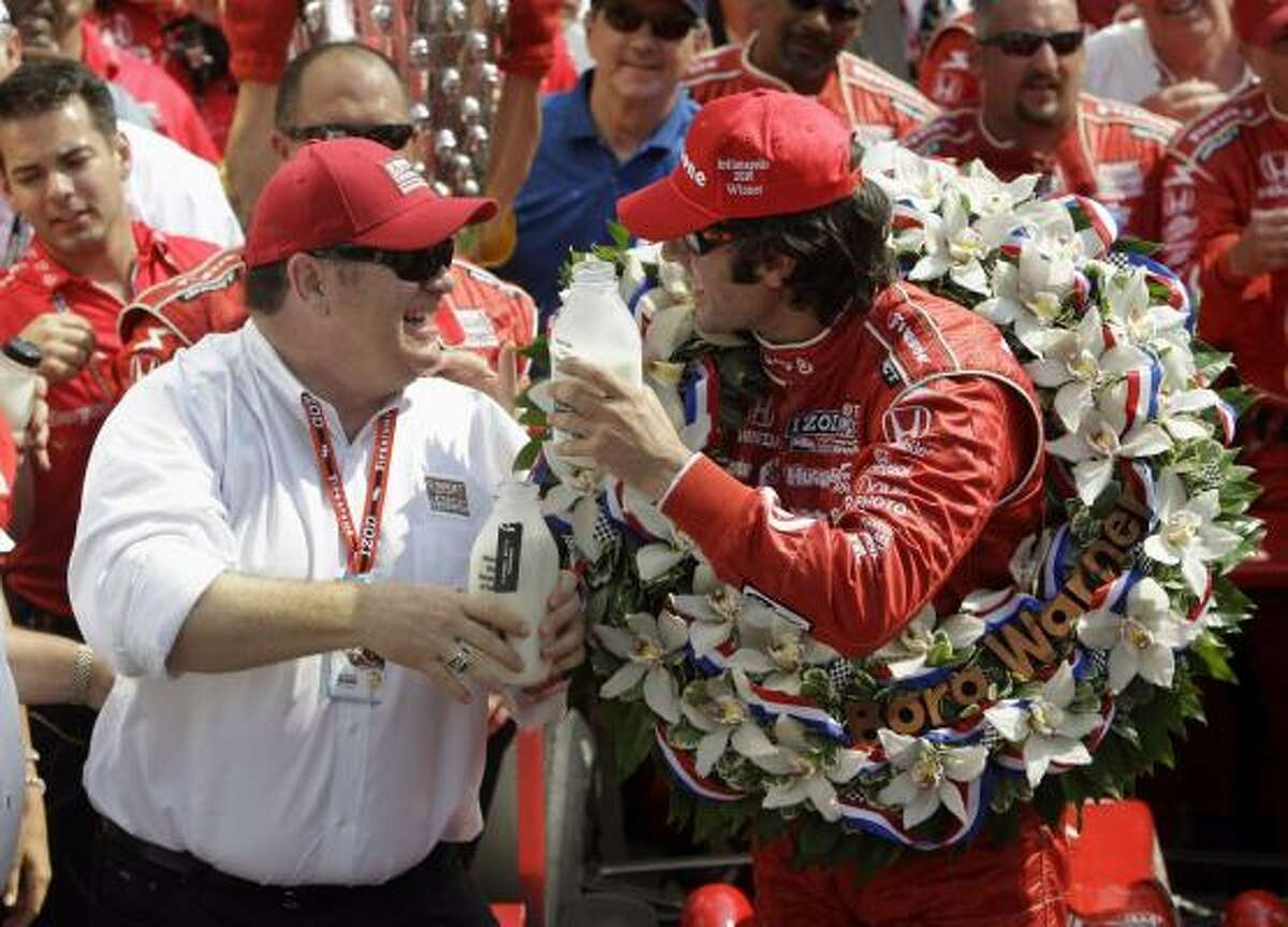 Dario Franchitti celebrates with car owner Chip Ganassi after winning the Indianapolis 500. The victory made Ganassi the first owner to win Indy and NASCAR's Daytona 500 in the same year.