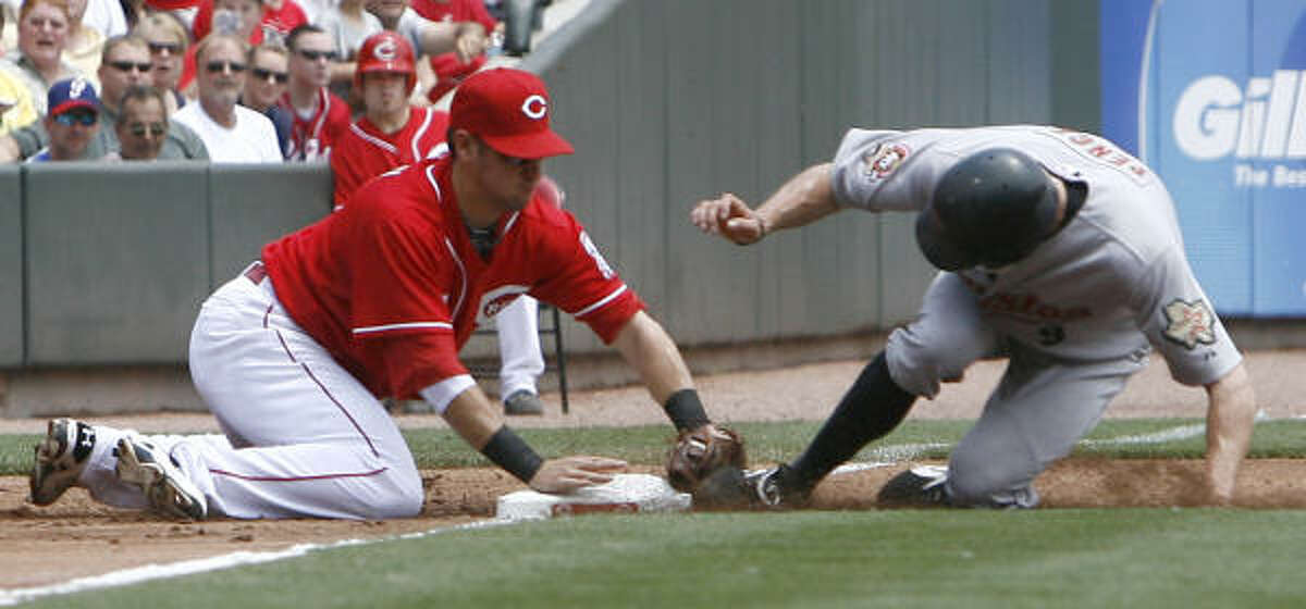 May 30: Astros 2, Reds 0 Astros right fielder Hunter Pence, right, is tagged out by Cincinnati Reds third baseman Paul Janish.