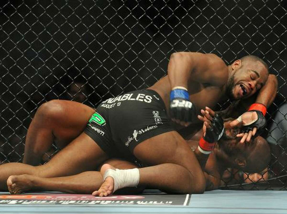 UFC fighter Rashad Evans, top, battles Quinton