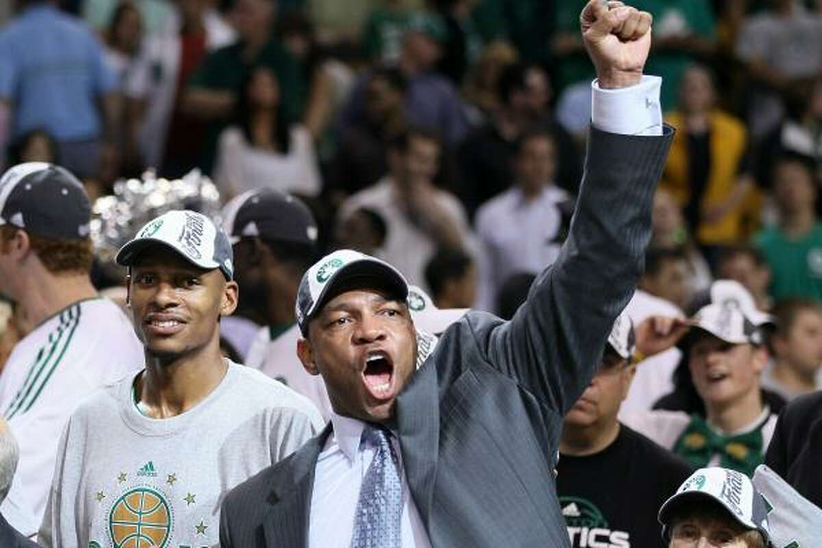 Game 6: Celtics 96, Magic 84 Coach Doc Rivers, Ray Allen and the other Boston Celtics celebrate after beating the Orlando Magic to clinch the Eastern Conference championship. The Celtics will face either the Lakers or the Suns in the NBA Finals.