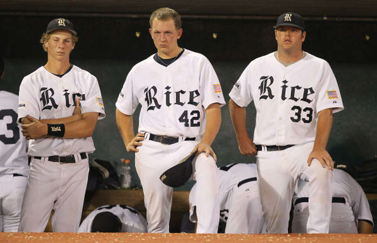Rice pitcher Tyler Duffey (42) and his teammates watch as Southern Miss celebrates its win in the Conference USA title game.