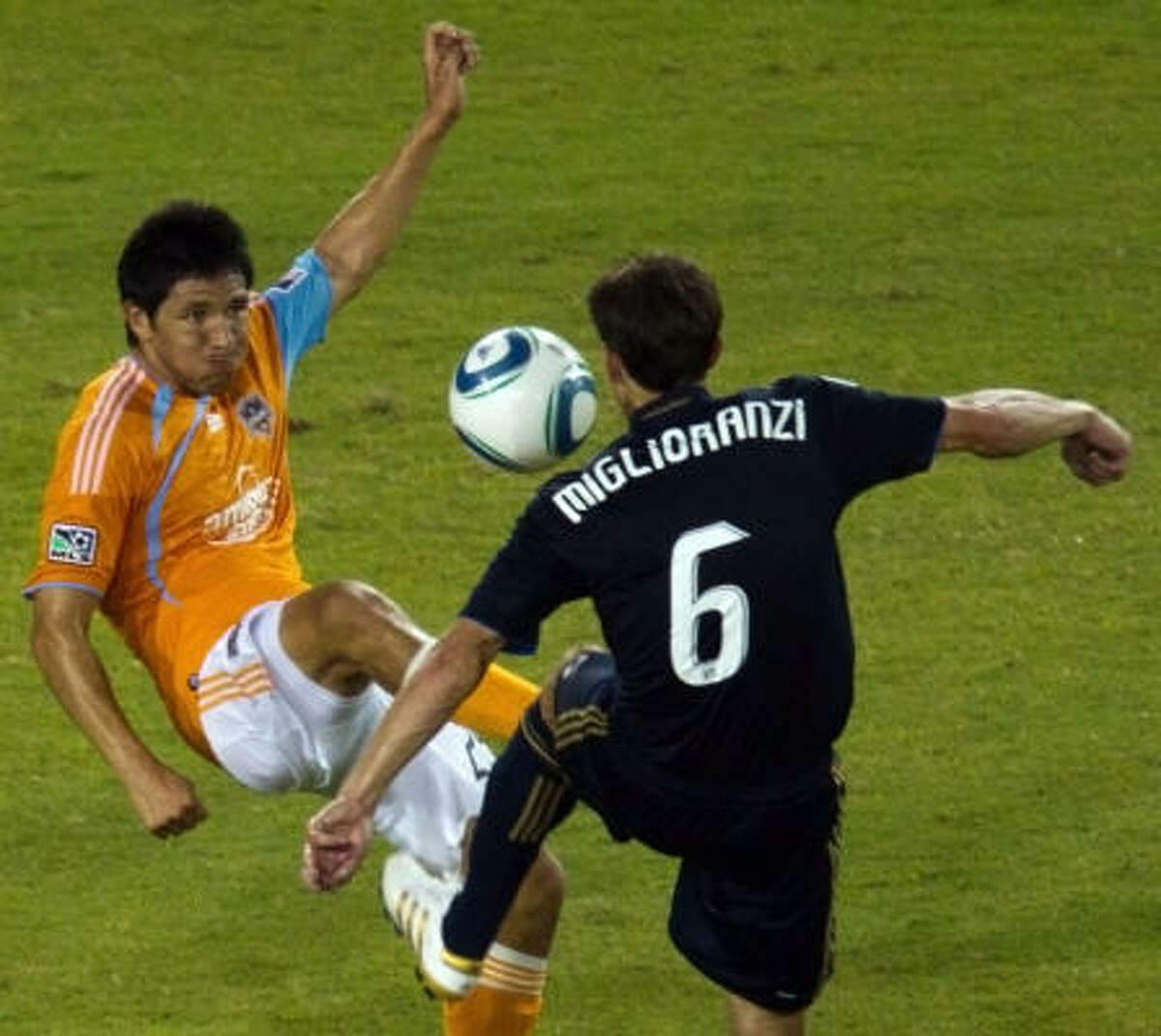 Brian Ching challenges Philadelphia's Stefani Miglioranzi for the ball during the second half.