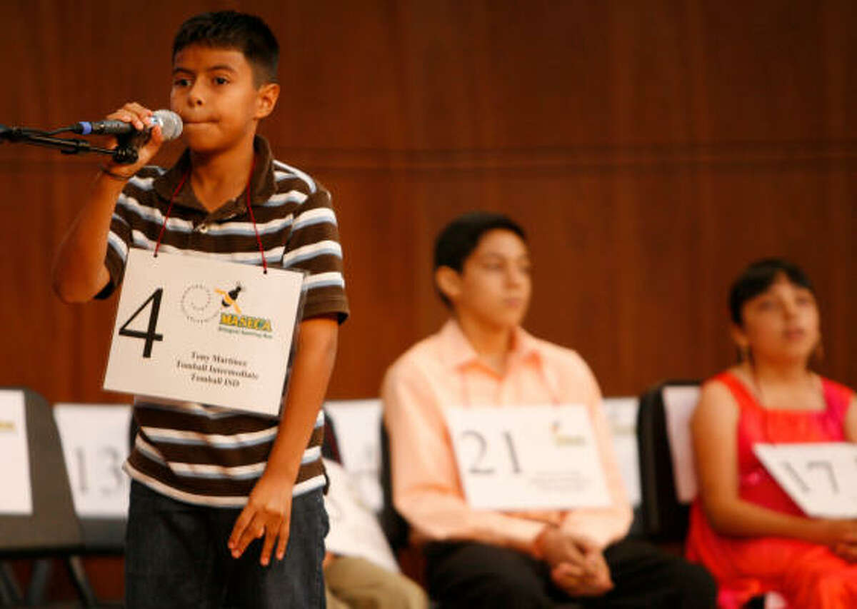 Tony Martinez, of Tomball Intermediate School, puts his spelling to the test at the Maseca Bilingual Spelling Bee at Houston Baptist University. Students from around Texas and Mexico competed.