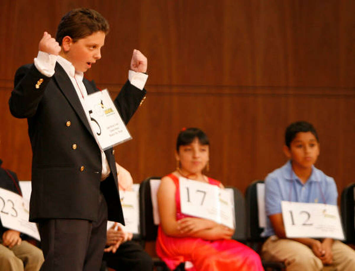 Isak Haras Green, of Eaton School in Mexico City, celebrates after spelling a word correctly in English and Spanish in the fifth round.