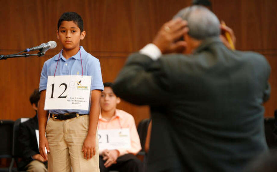 As a judge listens to an audio playback, Luis Garcia, of Klein's Mueller Elementary, waits to see how he fared. Photo: Julio Cortez, Chronicle