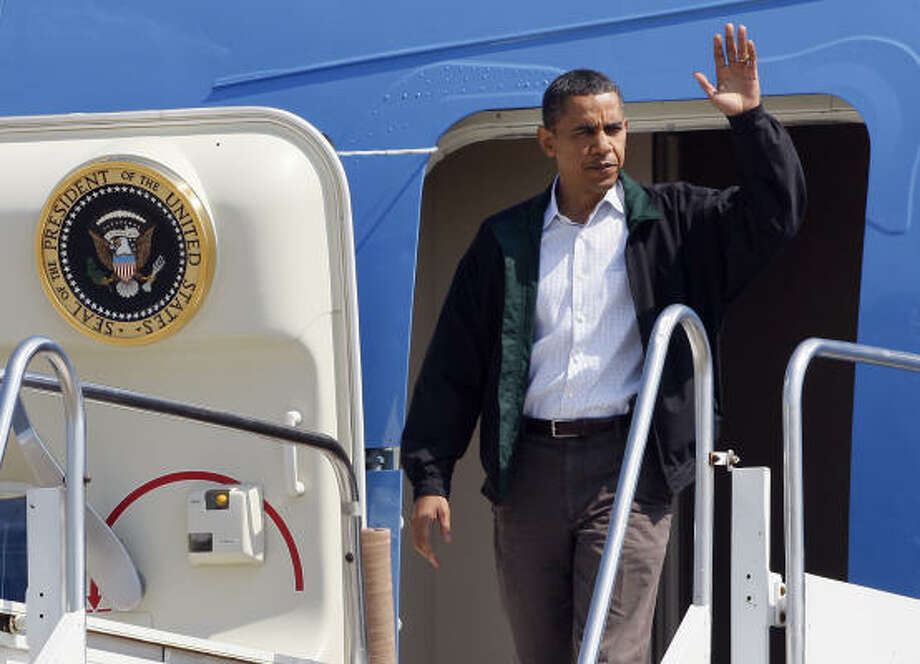 President Barack Obama waves as he steps off of Air Force One at Louis Armstrong International Airport in Kenner, La., on Friday, May 28, 2010. Photo: Patrick Semansky, AP