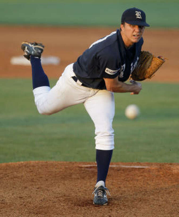 Rice pitcher Mike Ojala throws against the Houston Cougars. Photo: Melissa Phillip, Chronicle
