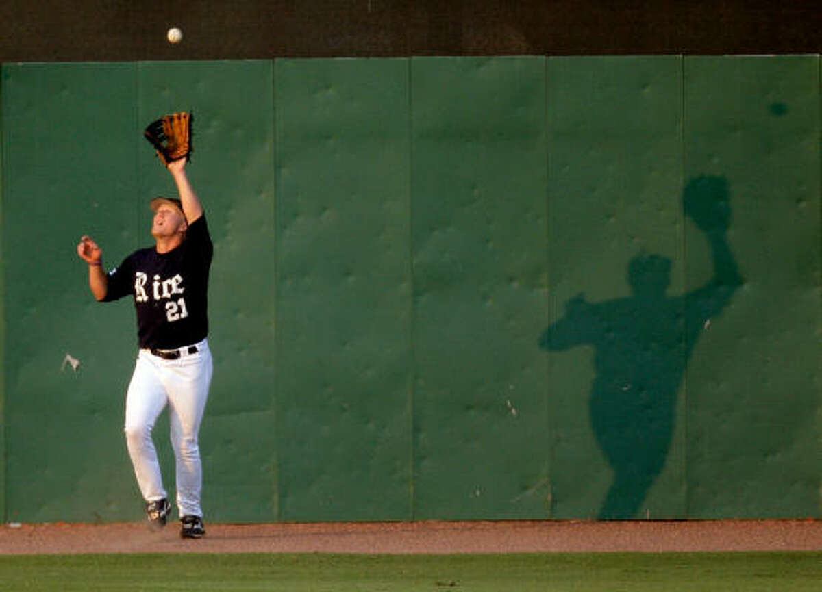 Rice outfielder Steven Sultzbaugh catches a fly by Houston catcher M. P. Cokinos in the second inning.
