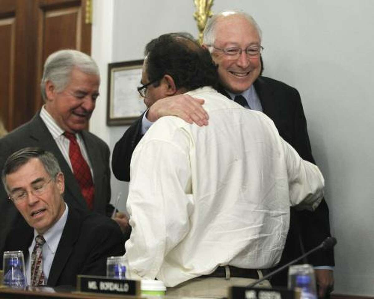 Interior Secretary Ken Salazar hugs Rep. Raul Grijalva, D-Ariz., on Capitol Hill on May 26, 2010, prior to testifying before the House Natural Resources Committee hearing on the