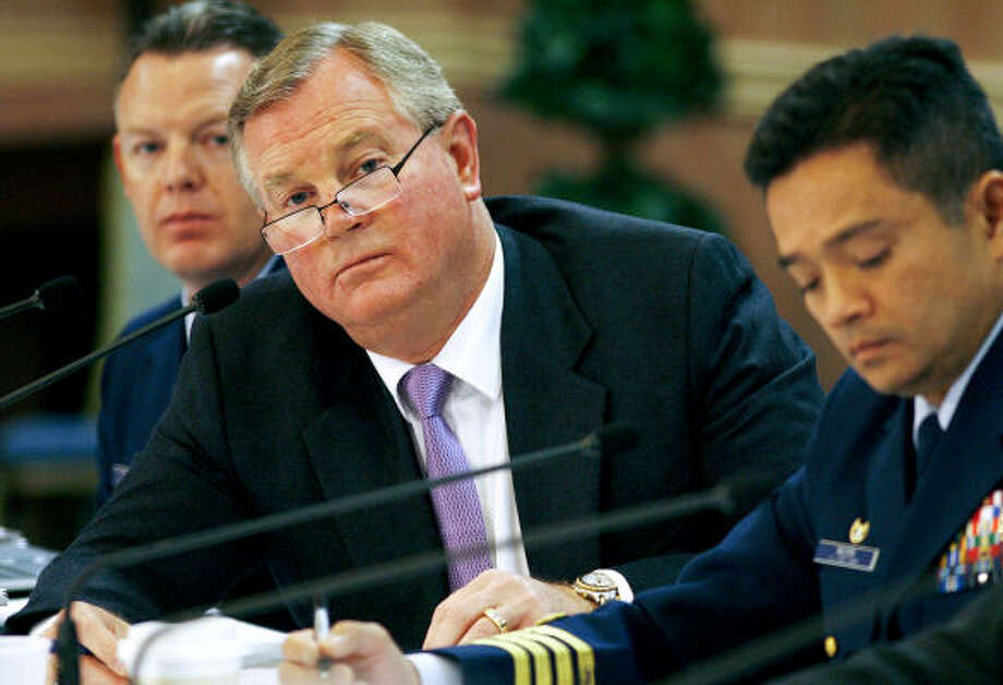Members of the Coast Guard and MMS team investigating the Deepwater Horizon disaster, from left, Lt. Robert Butts, Ross Wheatley, and Capt. Hung Nguyen, listen to testimony during  the Deepwater Horizon joint investigation in Kenner, La., on Wednesday, May 26, 2010. Photo: Chris Granger, Bloomberg
