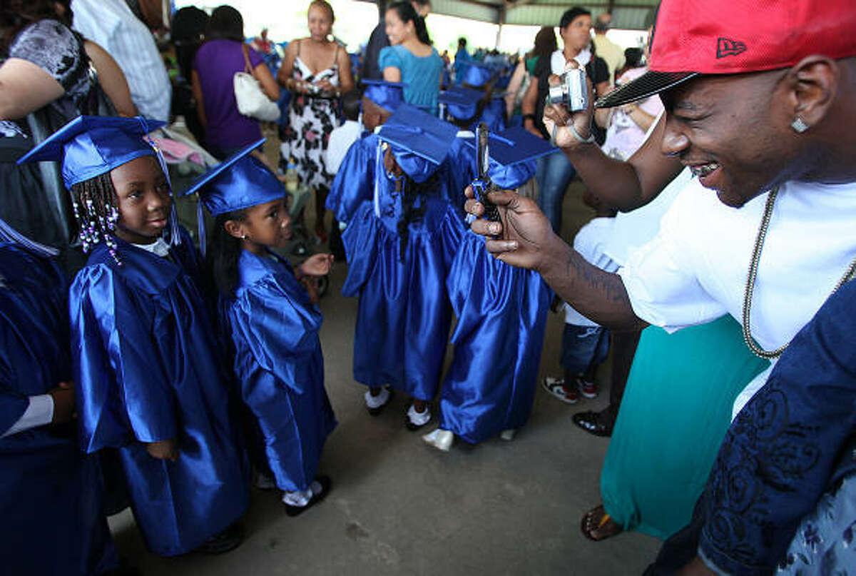 Amari Johnson, 5, poses for her cousin John Nathan Johnson at the ceremony.