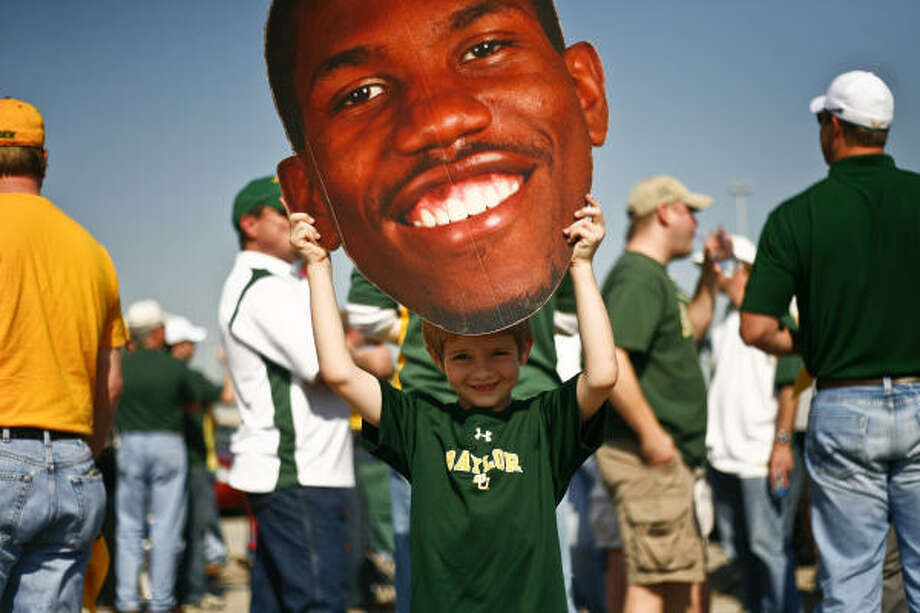 Brooks Farrell, 7, shows off an A.J. Walton cutout during a Baylor tailgating party before Friday's South Regional semifinal games at Reliant Stadium. Photo: Michael Paulsen, Chronicle