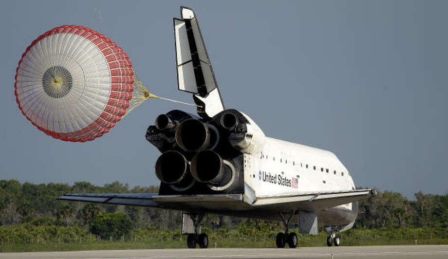 Astronauts on the space shuttle Atlantis deploy her braking parachute during landing on Kennedy Space Center's Runway 33 on May 26, 2010, in Cape Canaveral, Fla. Story: Shuttle Atlantis makes final landing after 120 million miles Photo: Chris O'Meara, AP