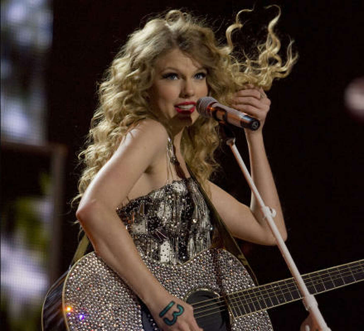 Taylor Swift performs during her Fearless Tour concert at Toyota Center in Houston, Texas. Click here for Joey Guerra's review: