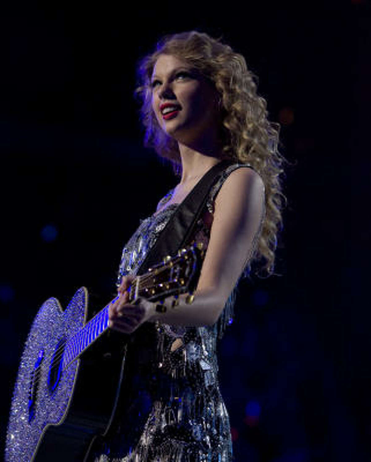Taylor Swift performs during her Fearless Tour concert at Toyota Center in Houston, Texas.