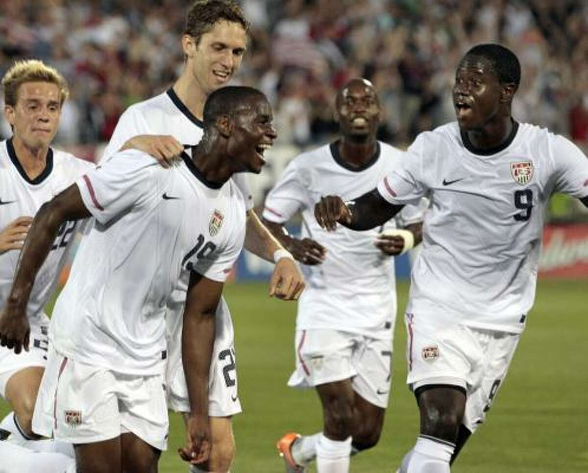 United States' Maurice Edu celebrates his goal against the Czech Republic with teammates Eddie Johnson, right, DaMarcus Beasley, second from right, Stuart Holden, left, and Clarence Goodsen, second from left, during the first half of an international friendly soccer match in East Hartford, Conn.,
